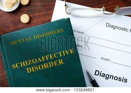 Schizoaffective disorder concept. Diagnostic form and book on a table. poster