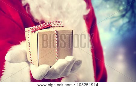 Santa Claus Giving A Present