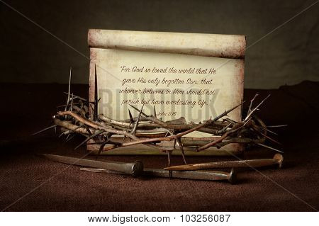 Bible Scripture with crown of thorns and nails over cloth - John 3:16
