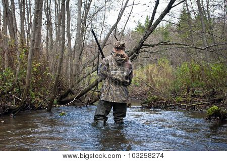 Woman Hunter In Waders On The River