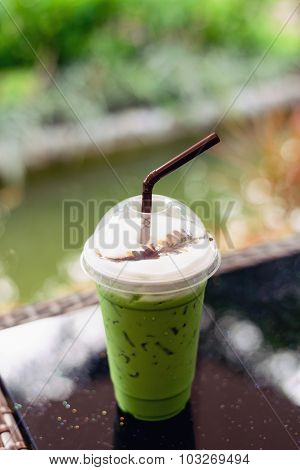Matcha Green Tea Latte Clod  On Wooden Table Background