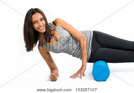 Young woman doing Fascia Muscle Training with a Fascia Roll. Fascia Training describes movement exercises that attempt to improve the functional properties of the muscular connective tissues.