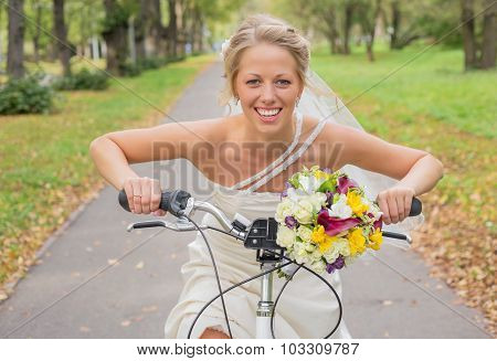 Bride riding a bicycle