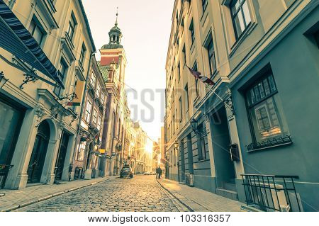 Vintage Retro Travel Postcard Of A Narrow Medieval Street In Old Town Riga At Sunset