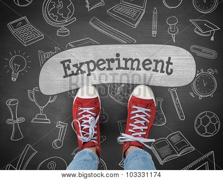 The word experiment and casual shoes against black background