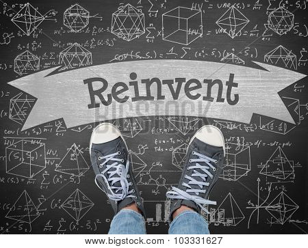 The word reinvent and casual shoes against black background