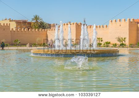 TAROUDANT, MOROCCO, APRIL 9, 2015: Big fountain in front of historic ramparts