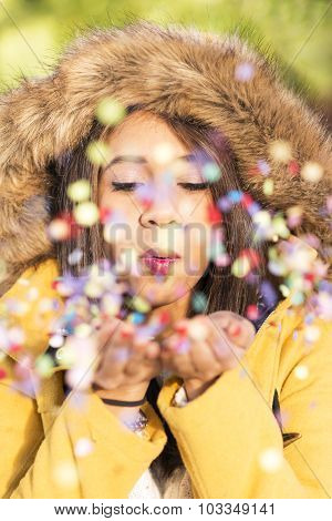 Portrait Of Beautiful Woman Blowing Confetti In The Air, Party New Years And Holidays Concept.