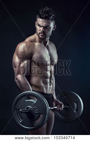 Muscular Bodybuilder Guy Doing Exercises With Big Dumbbell