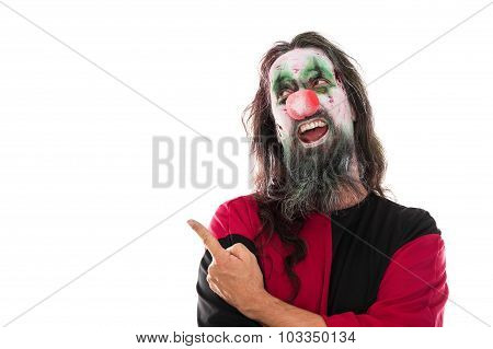 Creepy bloody clown pointing with his finger to copyspace isolated on white concept costume or halloween poster