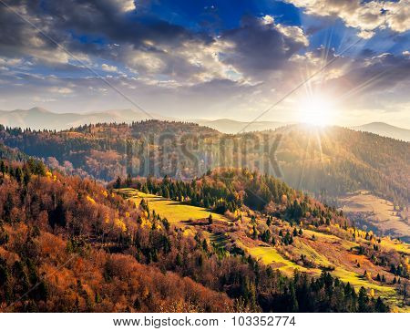 Autumn Hillside With Colorful Foliage Trees Near Valley At Sunset