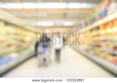 Blurred Defocused Background Of Generic Supermarket Lane- Concept Of Consumerism