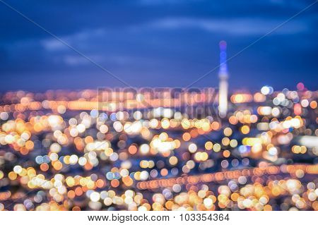 Defocused Bokeh Of Auckland Skyline From Mount Eden After Sunset During The Blue Hour - New Zealand