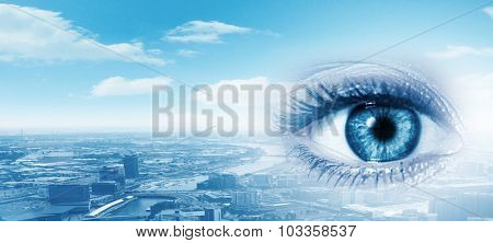 Close up of female eye with panoramic view at background