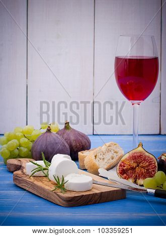 Cheese With Ripe Figs And Wine On Blue