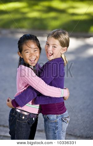 Best Friends Hugging And Laughing