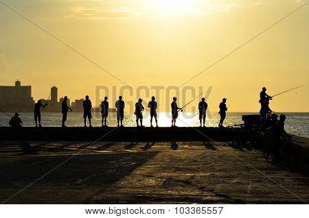 Fishing during the sunset in Havana (Cuba)