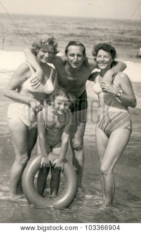 SOPOT, POLAND, CIRCA 1960: Happy family with a little girl poses on beach