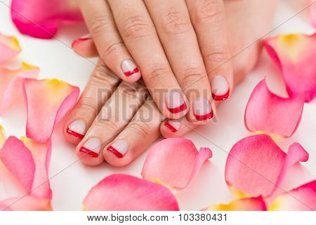 Close-up Of Female Hands With Manicured Red Nail Varnish poster