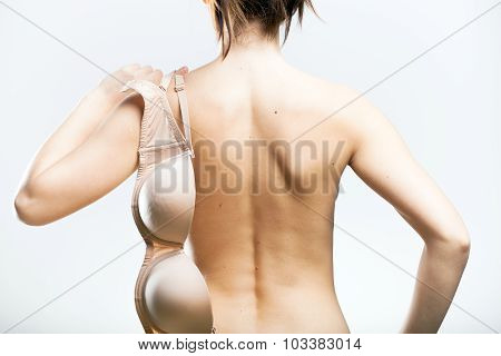 Bra Hanging On Woman Back Symbol Of Temptation