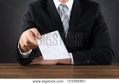 Businessperson Giving Cheque