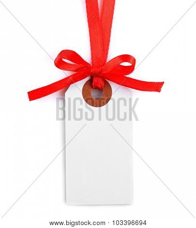 Blank gift tag with bow isolated on white