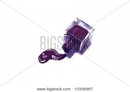 Purple Nail Polish Bottle With Splatters Isolated On White Background