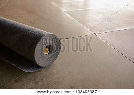 The Roll Of Black Carpet At The Constructionsite