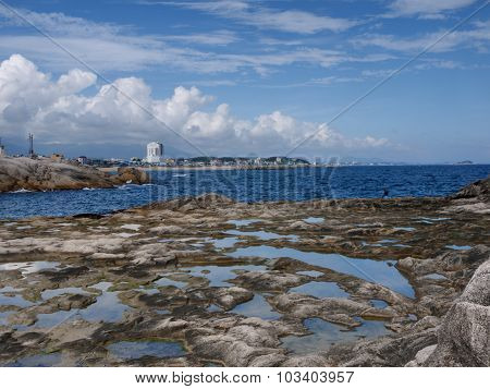 Beautiful seascape with rocks and blue sky