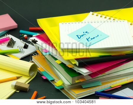 The Pile Of Business Documents; Don't Know