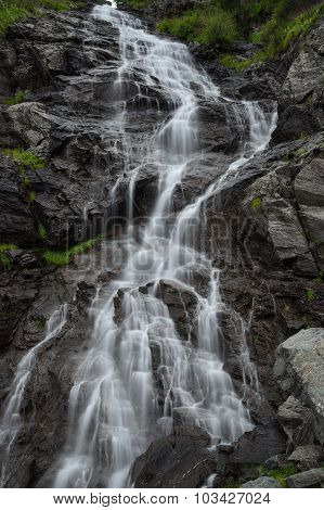 Fast Mountain Waterfall In Vertical Orientation