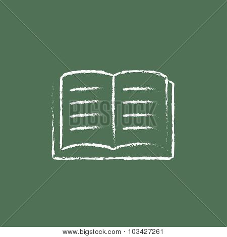 Open book hand drawn in chalk on a blackboard vector white icon isolated on a green background.