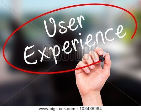 Man Hand writing User Experience with black marker on visual screen