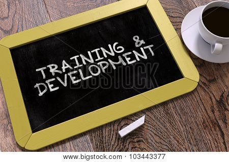 Hand Drawn Training and Development Concept on Chalkboard.