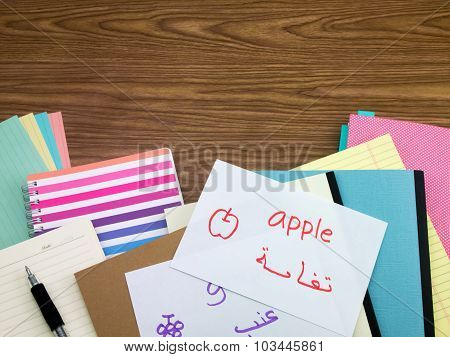 Arabic; Learning New Language Writing Words On The Notebook
