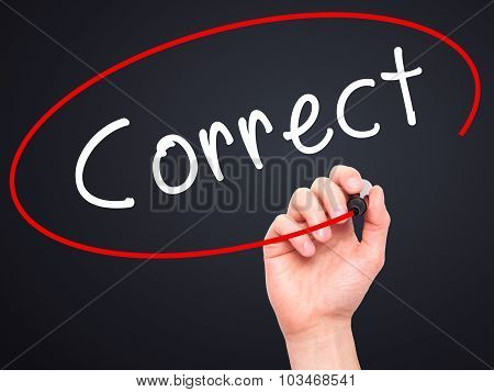 Man Hand writing Correct with black marker on visual screen.