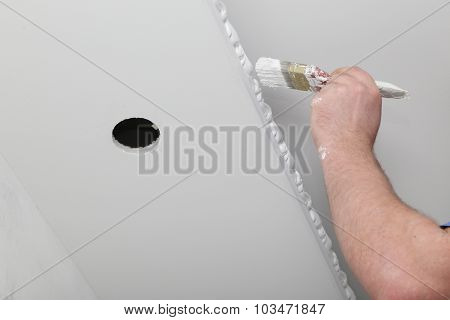 Renovation of house interior. Brush with paint