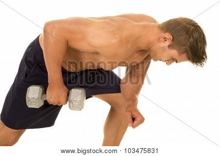a shirtless man working on his tricep with a weight. poster