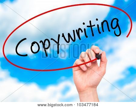 Man hand writing Copywriting on visual screen.