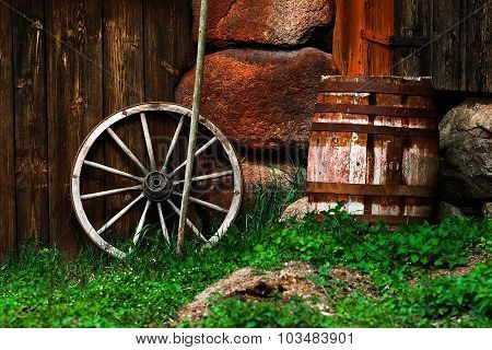 Still-life With An Old Wheel And Barrel