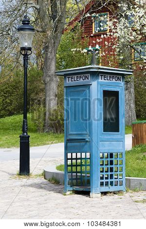 Phone Booth And Old Lantern