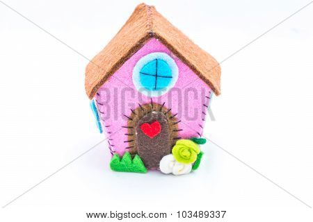 Aback home. Home sweet home the concept of home. Felt creations and abstract concept of miniature house cheerful and colorful for recurrences. poster