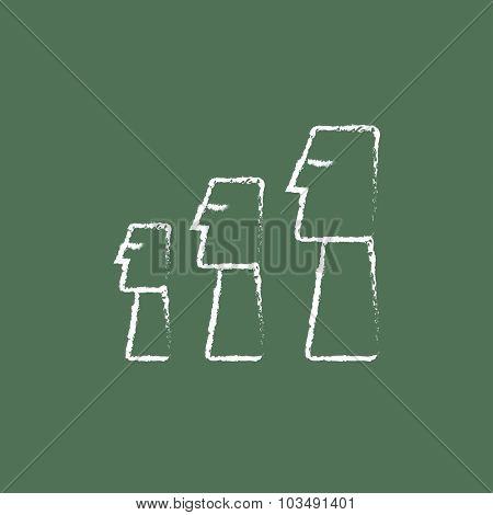 Moai statues on Easter Island hand drawn in chalk on a blackboard vector white icon isolated on a green background.