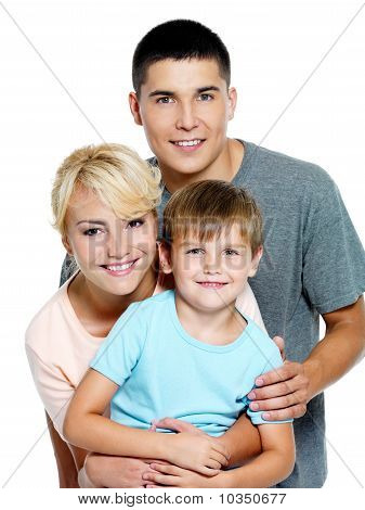 Happy Young Family With Son Of 6 Years