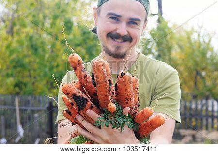 Farmer Offering Carrots