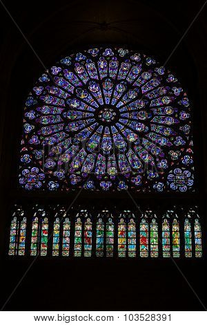 PARIS, FRANCE - SEPTEMBER 8, 2014: Paris Notre Dame Cathedral. North transept rose window. The Glorification of the  Mary
