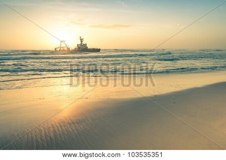 Shipwreck At Sunset On The Namibian Skeleton Coast - Nature Wonders Of Africa In West Namibia