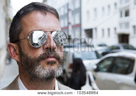 Man In Suit With glasses In The Street