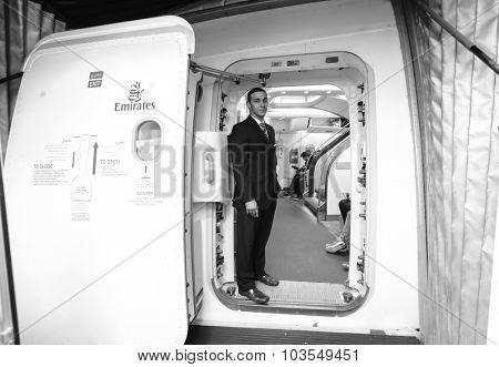 HONK KONG- OCTOBER 17, 2014: Emirates crew member meet passengers in Airbus A380 aircraft. Emirates handles major part of passenger traffic and aircraft movements at the airport.