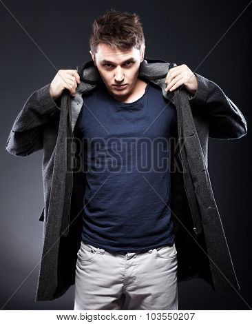 Handsome Smiling Young Man In Coat